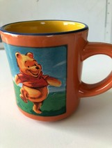 Winnie The Pooh Mug Bear The Disney Store Orange Yellow Blue dancing - $12.86
