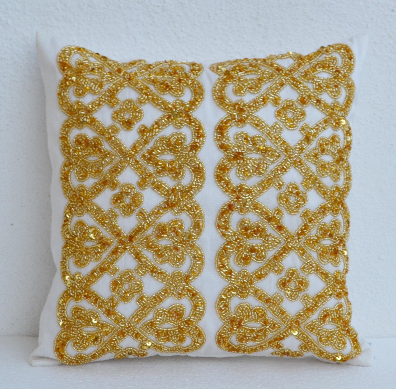 white geometric throw pillows beaded detail gold bead