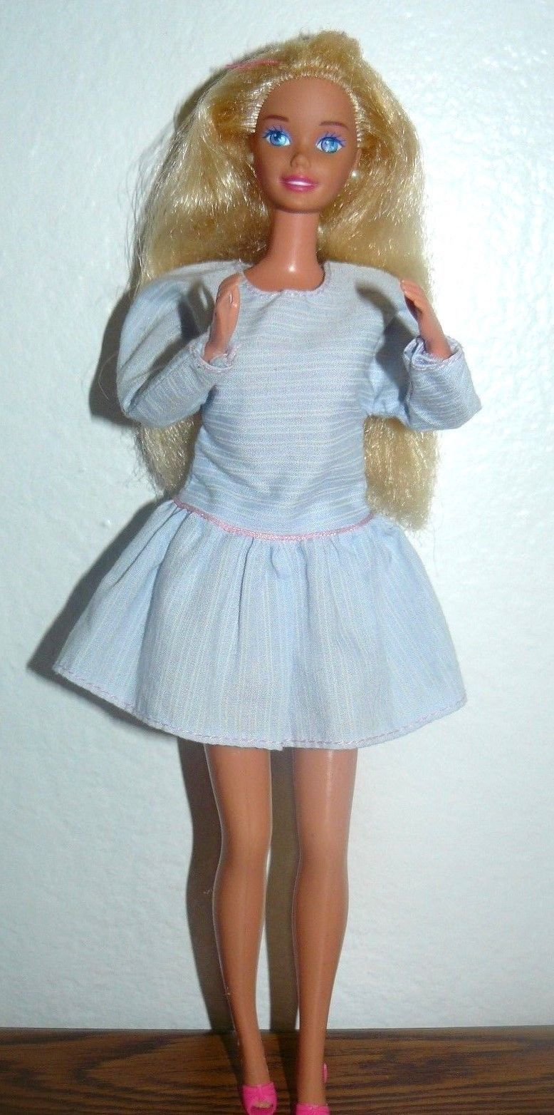 2c9c5f13df88 57. 57. Previous. Mattel Blond Barbie Doll in light blue dress pink shoes  white earrings · Mattel ...