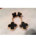 Double hanging motif onyx earrings - $45.00