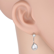 UE- Silver Tone Designer Earrings With Striking Pear Shaped Faux White Sapphire - $18.99