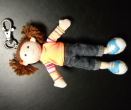 Russ Key Chain Little Brown Haired Cloth Girl wearing Blue Jeans and Orange Top - $6.99