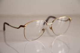 NIGURA  Eyewear, Gold Frame, RX Able Clear Lenses Prescription. - $50.49