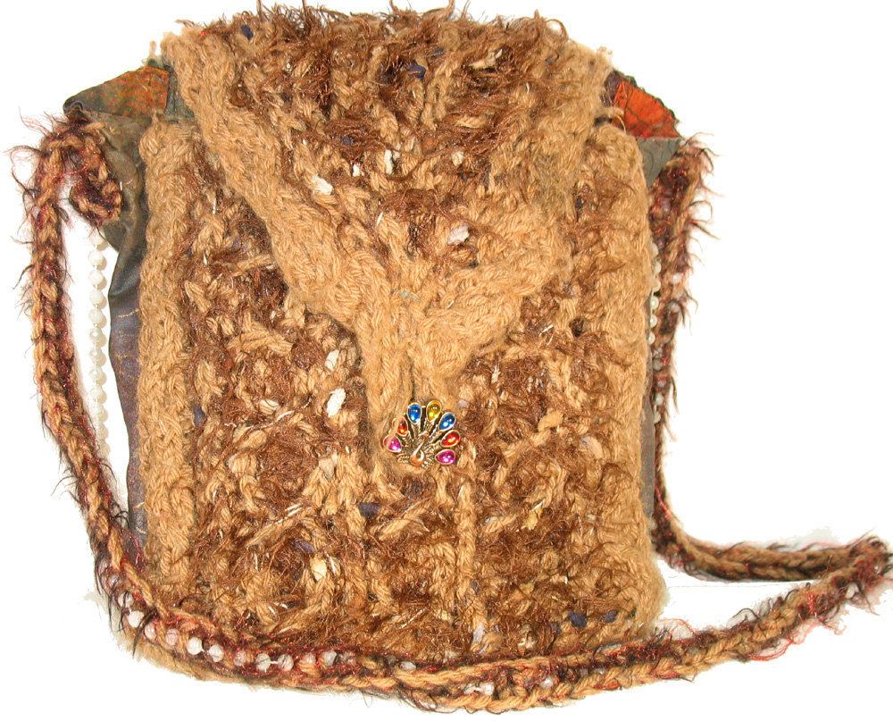 Brown hand knit handbag with inner pockets and strap