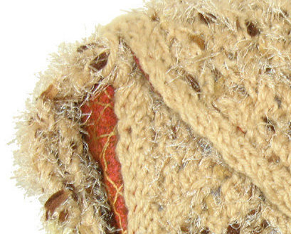 Tan hand knit handbag with inner pockets and strap