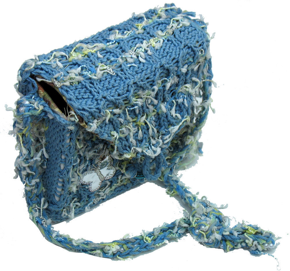 Funky blue hand knit handbag with silver butterfly