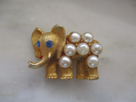 Vintage Gold Tone Imitation Pearl & blue Rhinestone Small Elephant Pin o... - $5.00