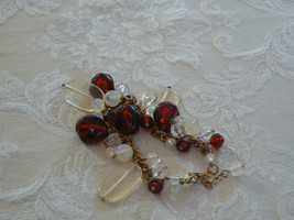 Vintage Sweet Unmarked Goldtone Clear Red White Plastic Bead Dangle Brac... - $5.04
