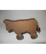 Figurine Cow Rolling Wheels Wood Hand Carved  - $7.95