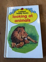 "1990s ""LOOKING AT ANIMALS"" LADYBIRD BOOK ( NET) - $1.25"
