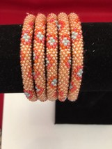 Roll On Glass Seed Beaded Bracelet Gold Pink Orange Glass Beaded Bangles... - $3.99