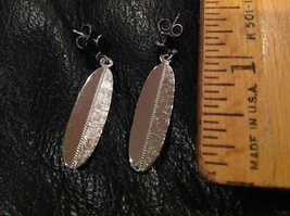 "1.25"" long Dangling Silver Tone Earrings, feather- or leaf-like, posts p... - $8.89"