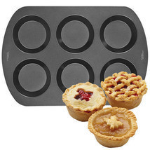 Wilton 6 Cavity Mini Pie Pan Non-stick - $230,30 MXN