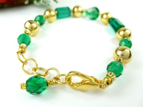 Round faceted green glass and gold beaded holiday