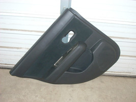 2010 NISSAN VERSA  LEFT REAR DOOR TRIM PANEL