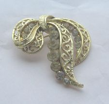 CLEAR RHINESTONES ON GOLD COLOR METAL RIBBON SHAPED PIN - $9.89