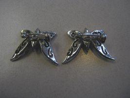 TWO SMALL SILVER AND BLACK BUTTERFLY PINS - $9.89