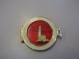 GOLD COLOR LIGHTHOUSE SEALED IN RED HAS CREAM ENAMEL AROUND IT BROOCH - $9.89