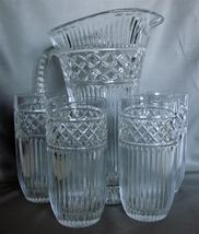 Fifth Ave Crystal Ribbed Pitcher AND Set of Four Matching Glasses - $55.00