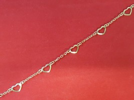 """14kt yellow gold bracelet.  7"""" gold chain bracelet with 5 open hearts. - $79.19"""