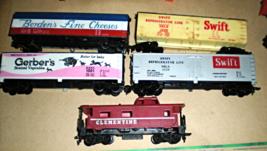 HO trains  5 train car (1 Bordens, 2 Swift, 1 Gerber & 1 Caboose) - $21.95
