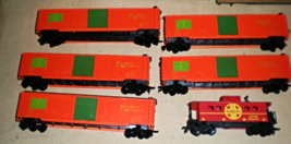 HO trains  5 Box cars ( Main Central) & 1 Caboose ( Santa Fe) - $14.90