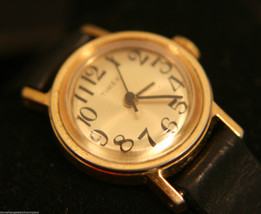 Strong running vintage 1980 Ladies' gold manual-wind, Timex wristwatch - $60.00