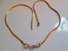 Pre Owned Gold Tone Fashion Necklace. Three Faux Light Amethyst Stones. - $12.00