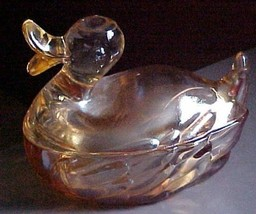 Depression era carnival/irridescent  colored glass  duck powder jar Jean... - $9.99