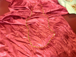 17 inch long gold colored necklace