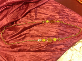 18 inch gold colored necklace with cream/brown figures image 1