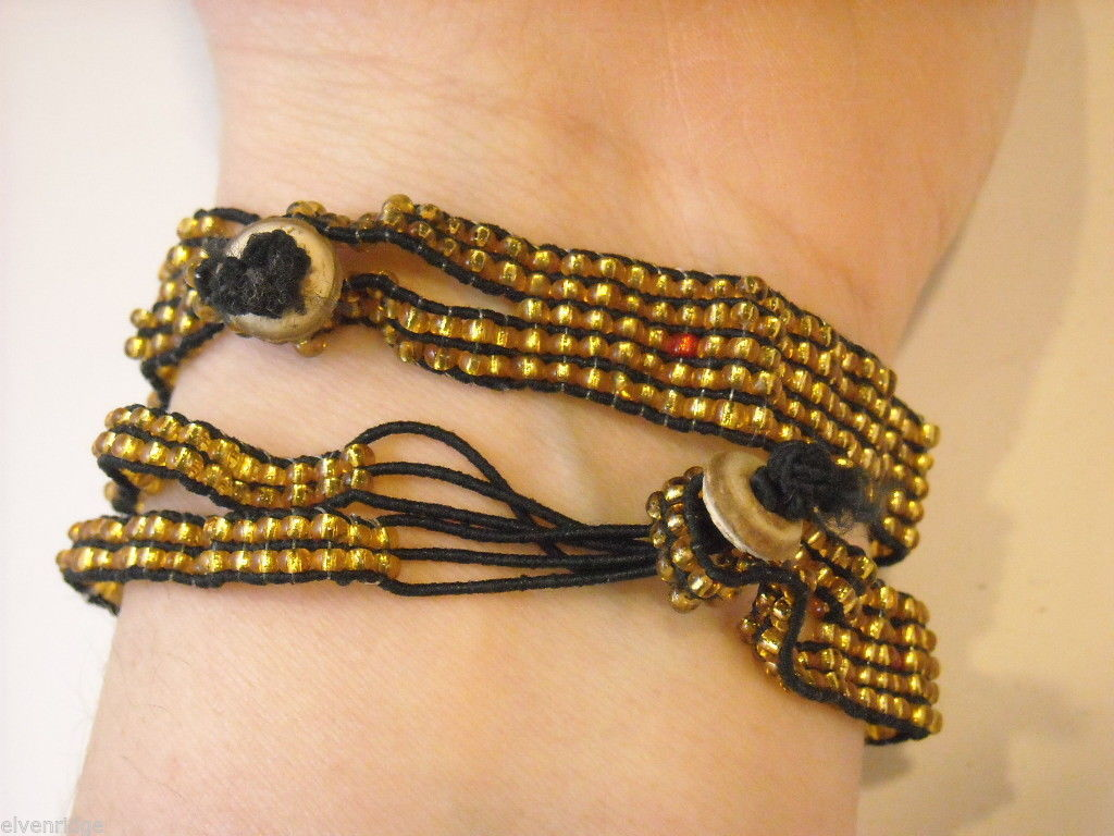 2 matching gold beaded bracelets