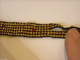 2 matching gold beaded bracelets image 2