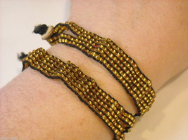 2 matching gold beaded bracelets image 5