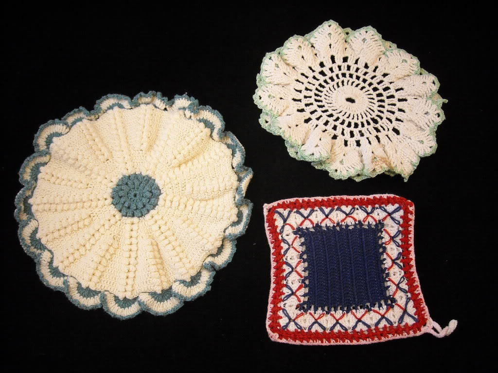 3 antique doilies and crocheted pot holder