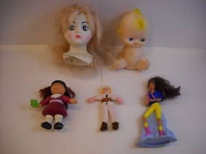 5 toy figures baby doll heads cabbage patch