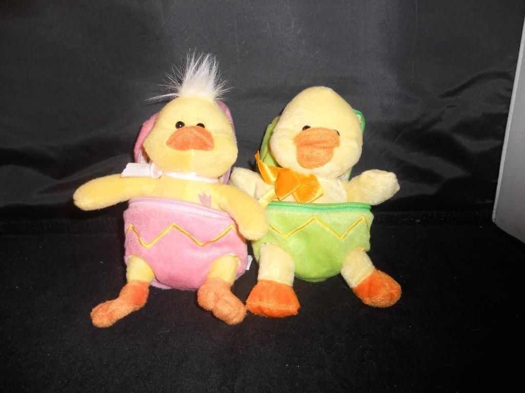 A pair of Plush Ducks in their eggs