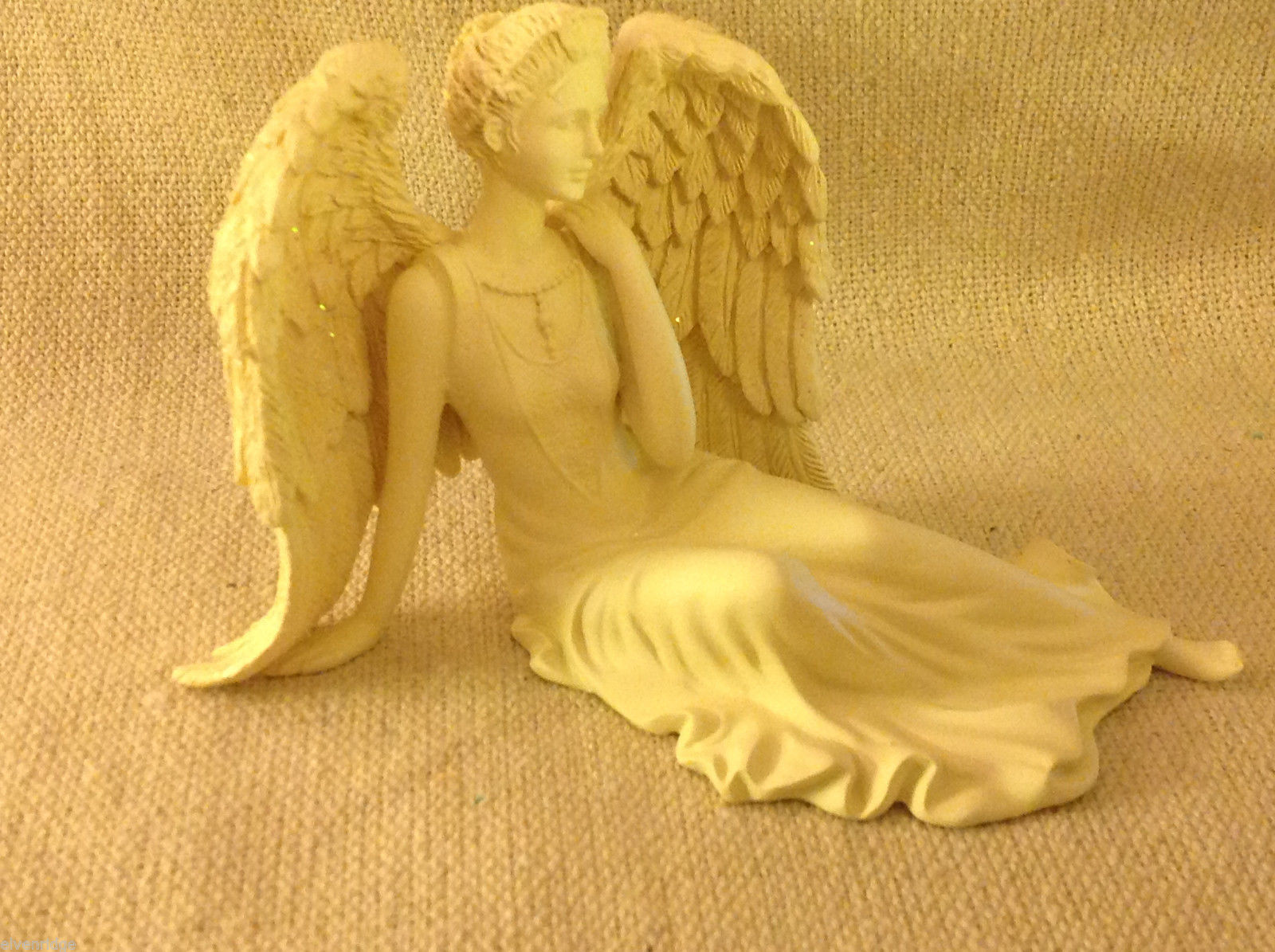 Angel Figurine  peacefully reclining with resting wings tabletop new in box