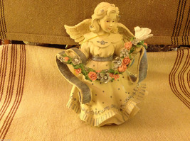 Angel Figurine with garland of colorful flowers and bird