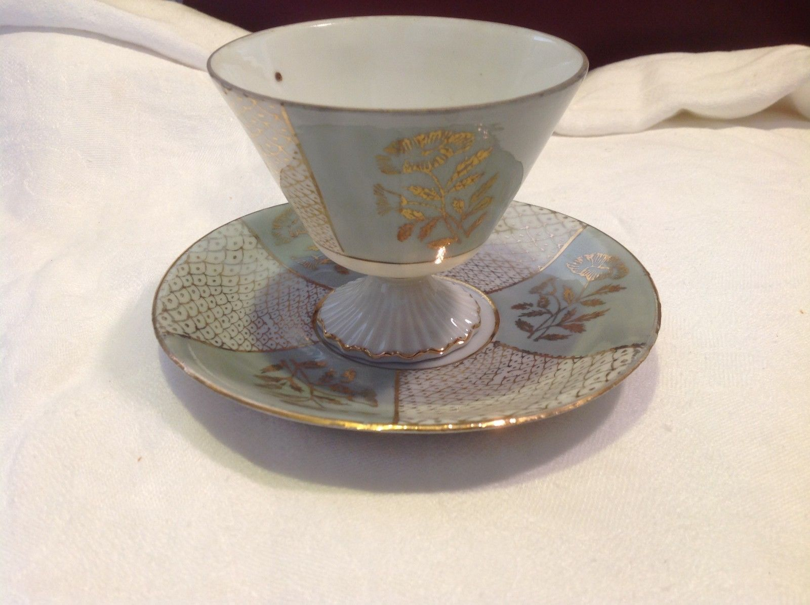 Antique cup saucer lt blue pedestal w florals scale gold trim National Potteries