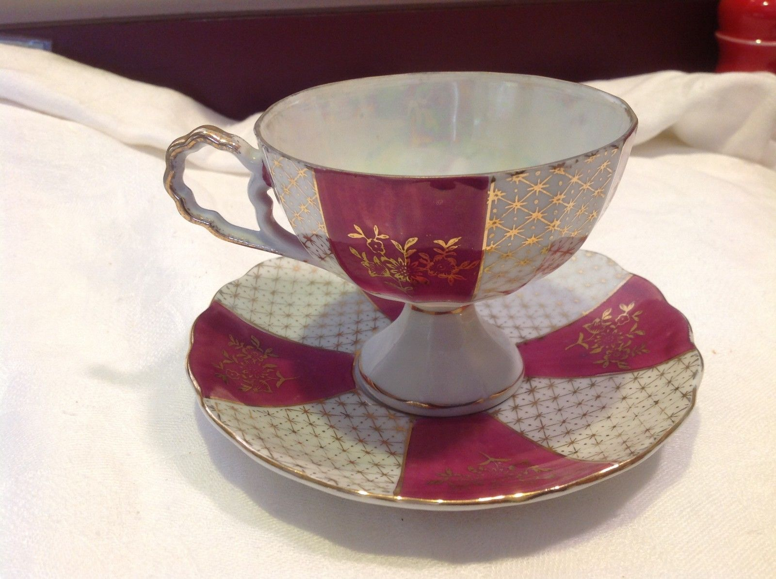 Antique cup saucer magenta pedestal w florals stars gold trim National Potteries