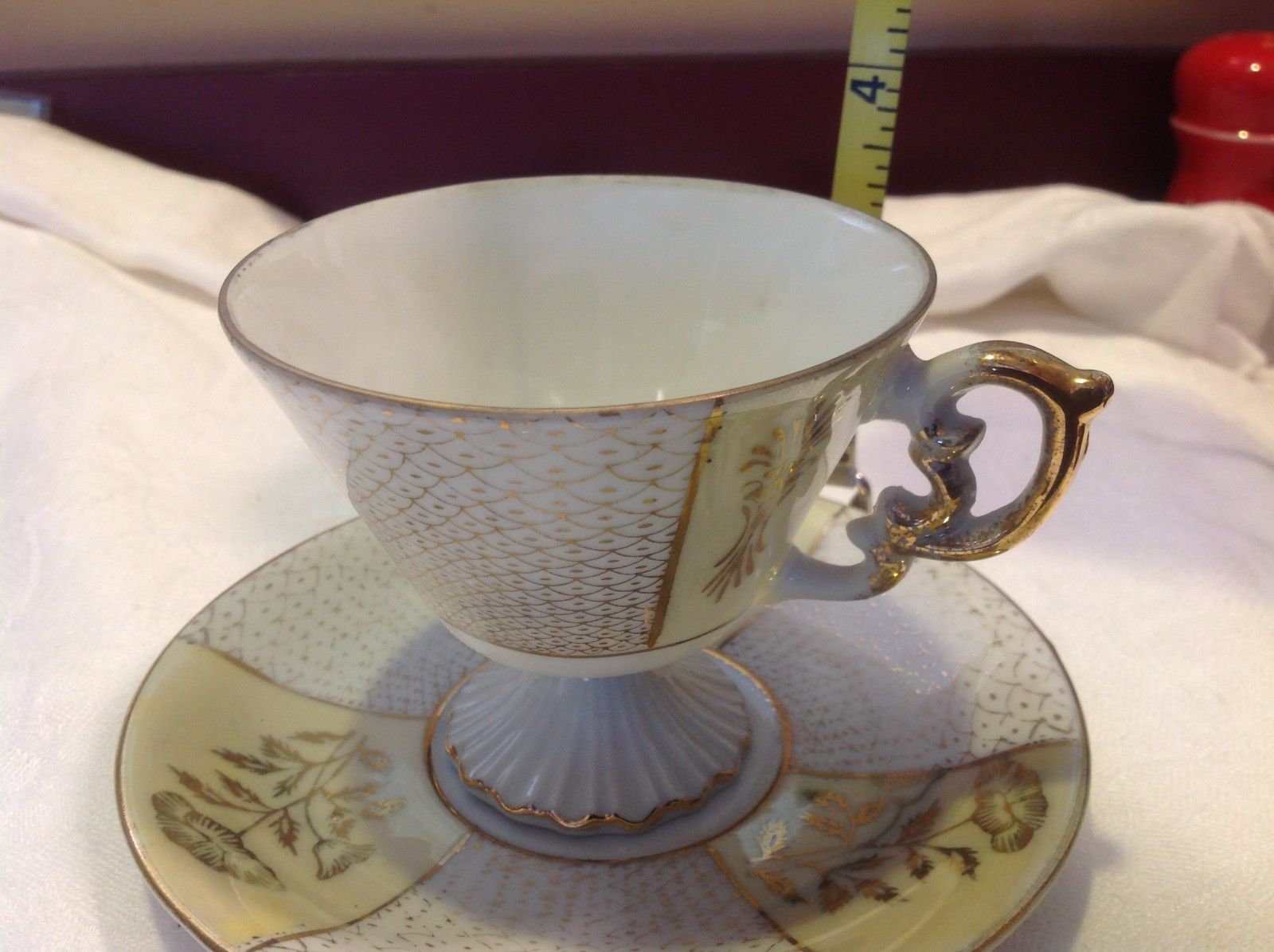 Antique teacup saucer canary floral stars pedestal gold trim National Potteries