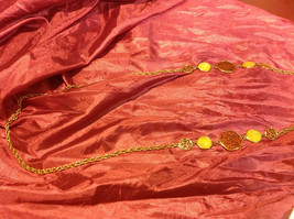 18 inch gold colored necklace with cream/brown figures image 2