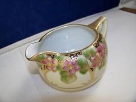 Asian inspired porcelain creamer hand painted