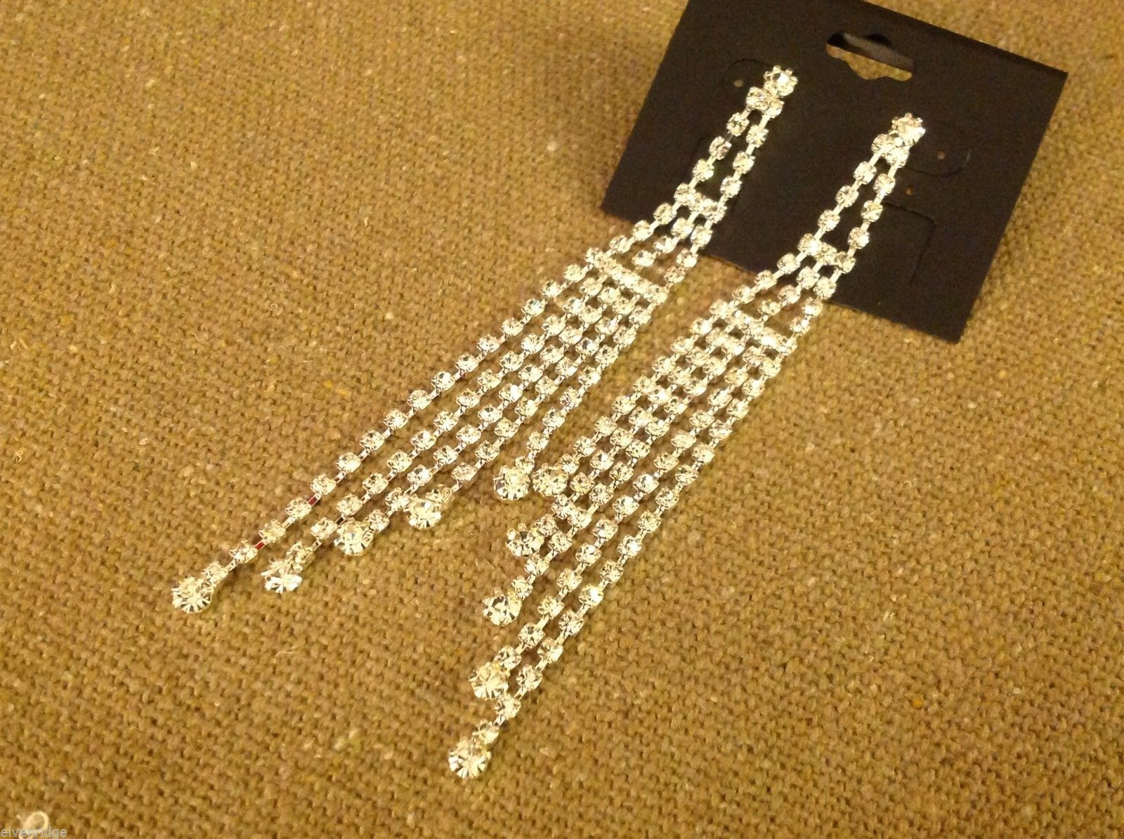 Beautiful silver plated and loads of rhinestones 4 inch drop earrings sparkly
