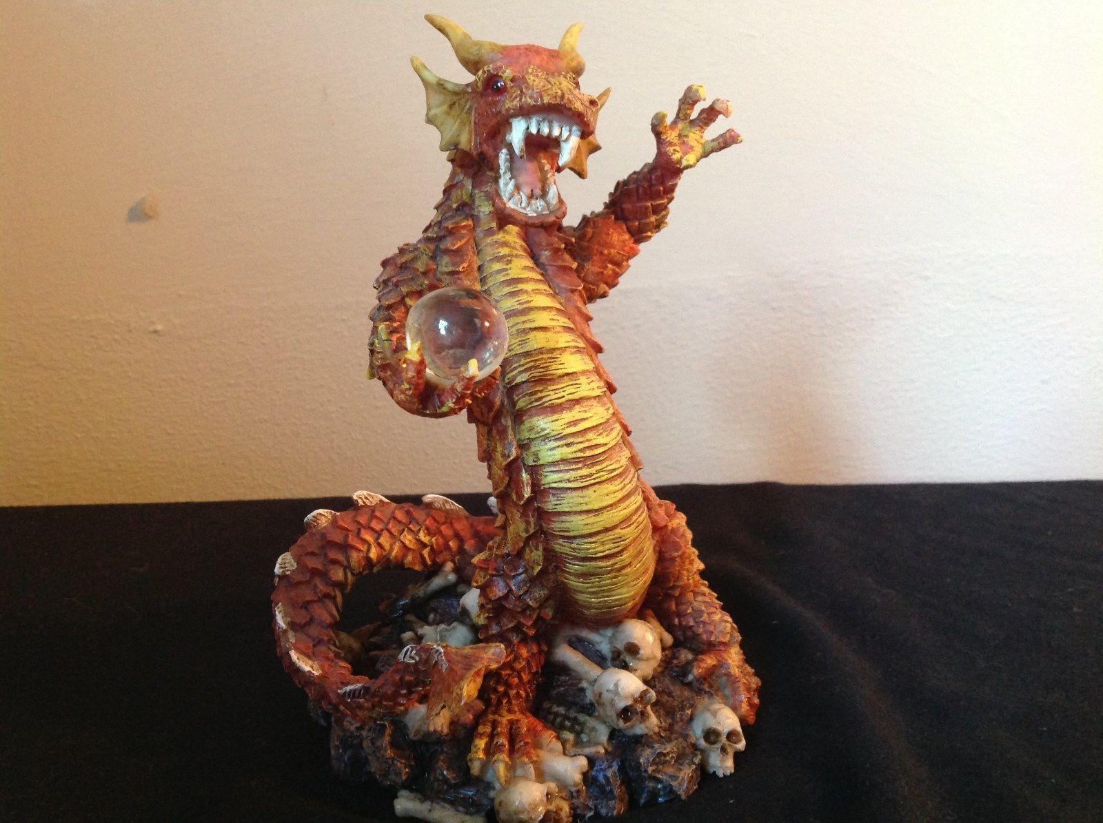 Big Red Dragon Statue Guarding Crystal Ball Skulls and Bones