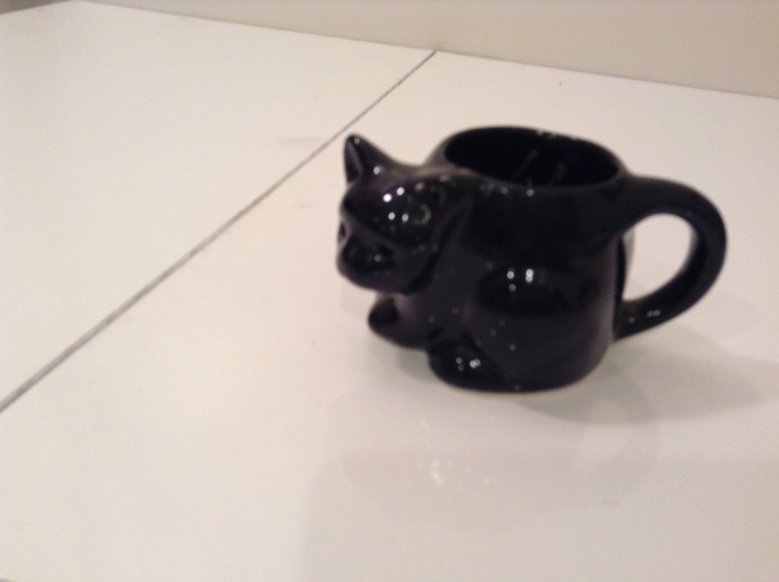 Black Cat Candle Holder Four and a Half Inches Candle Opening Two Inches Tall