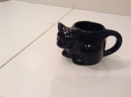 Black Cat Candle Holder Four and a Half Inches Candle Opening Two Inches Tall - $39.99