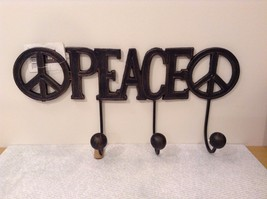 Black Metal Coat Rack with PEACE Signs on Each Side of Word PEACE - $39.99