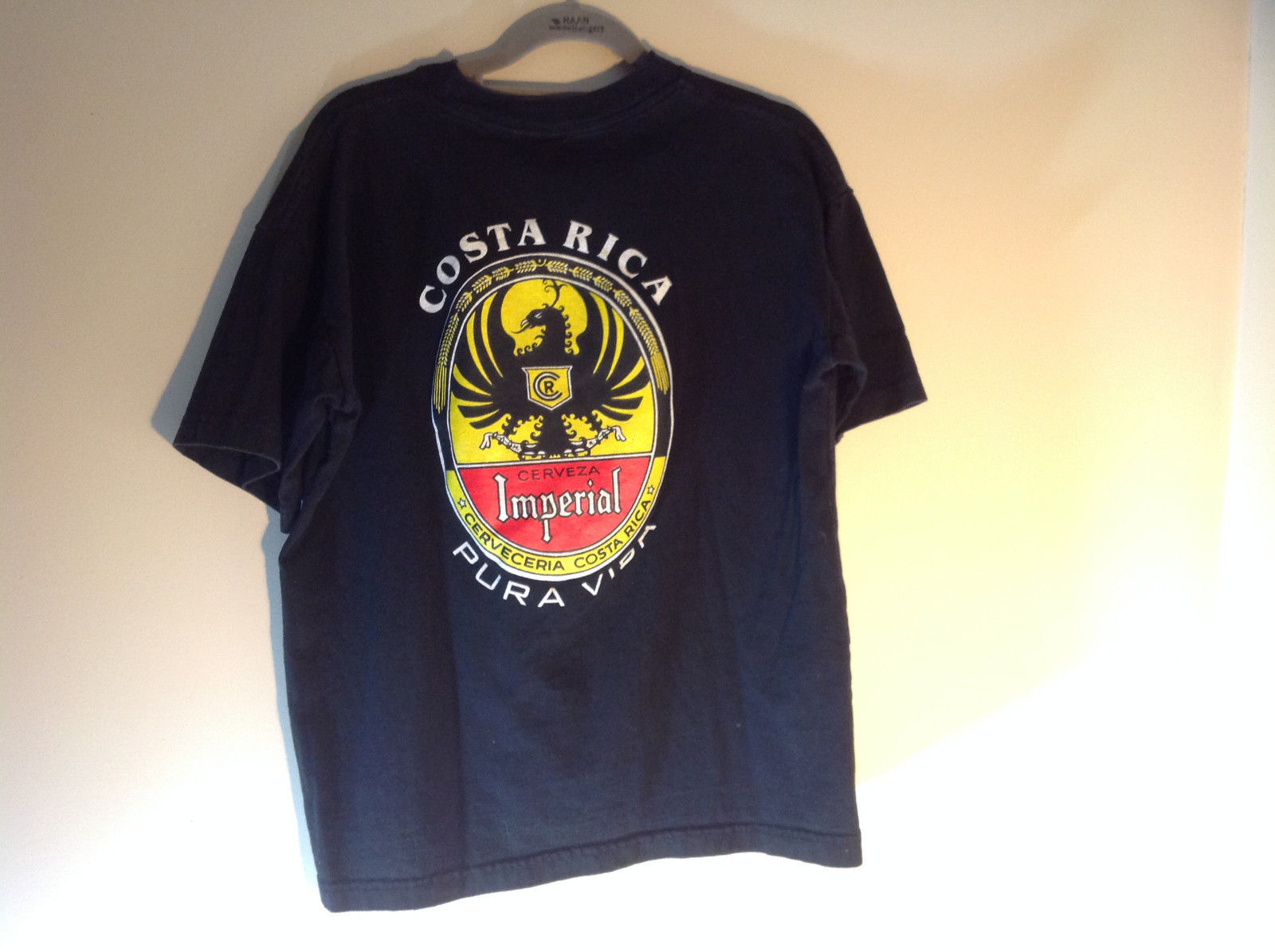 Black Short Sleeve Graphic T-shirt with White Emblem on Front Chest Size Medium